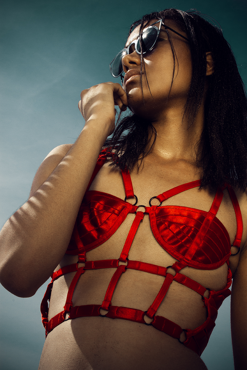 Chromat red buster top  black bottoms  stylists own sunglasses